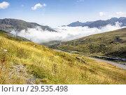 Купить «He is already dissipating the fog in the high mountains of Envalira in Andorra.», фото № 29535498, снято 6 сентября 2018 г. (c) easy Fotostock / Фотобанк Лори