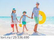 Купить «Father and kids enjoying beach summer vacation», фото № 29536690, снято 9 апреля 2017 г. (c) Дмитрий Травников / Фотобанк Лори