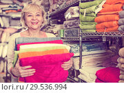 Купить «adult woman consumer with bath towel», фото № 29536994, снято 29 ноября 2017 г. (c) Яков Филимонов / Фотобанк Лори