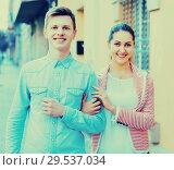 Купить «Cheerful girl and handsome man having a walk together», фото № 29537034, снято 14 декабря 2018 г. (c) Яков Филимонов / Фотобанк Лори