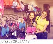Купить «Two women choosing underwear in shop», фото № 29537118, снято 20 марта 2019 г. (c) Яков Филимонов / Фотобанк Лори