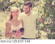 Купить «Young married couple planting plants», фото № 29537134, снято 19 марта 2019 г. (c) Яков Филимонов / Фотобанк Лори