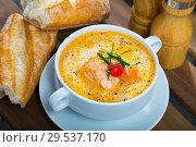 Купить «Delicious soup with salmon, served in bowl with fresh bread at table», фото № 29537170, снято 12 декабря 2019 г. (c) Яков Филимонов / Фотобанк Лори