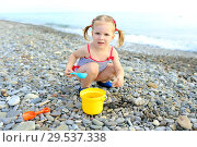 Cute happy little girl plays on the beach. Стоковое фото, фотограф ivolodina / Фотобанк Лори