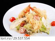 Купить «Seafood salad with shrimps, salad leaf, cherry tomato and parmesan cheese.», фото № 29537554, снято 16 марта 2018 г. (c) Евгений Глазунов / Фотобанк Лори