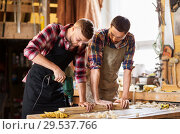 Купить «carpenters with drill drilling board at workshop», фото № 29537766, снято 14 мая 2016 г. (c) Syda Productions / Фотобанк Лори