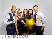 Купить «happy friends with golden party props posing», фото № 29537778, снято 3 марта 2018 г. (c) Syda Productions / Фотобанк Лори