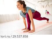 Купить «woman making high lunge exercise at yoga studio», фото № 29537858, снято 21 июня 2018 г. (c) Syda Productions / Фотобанк Лори