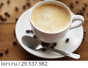 Купить «close up coffee cup and beans on wooden table», фото № 29537982, снято 7 апреля 2016 г. (c) Syda Productions / Фотобанк Лори