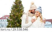 Купить «happy couple hugging over christmas tree», фото № 29538046, снято 3 октября 2015 г. (c) Syda Productions / Фотобанк Лори