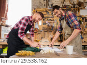 Купить «carpenters with ruler and blueprint at workshop», фото № 29538162, снято 14 мая 2016 г. (c) Syda Productions / Фотобанк Лори
