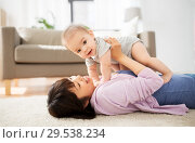 Купить «happy young mother with little baby at home», фото № 29538234, снято 5 мая 2018 г. (c) Syda Productions / Фотобанк Лори