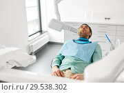 Купить «patient having x-ray scanning at dental clinic», фото № 29538302, снято 22 апреля 2018 г. (c) Syda Productions / Фотобанк Лори