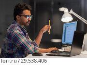 Купить «creative man working with laptop at night office», фото № 29538406, снято 24 января 2018 г. (c) Syda Productions / Фотобанк Лори