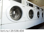 Купить «washing machines at laundromat», фото № 29538434, снято 28 февраля 2018 г. (c) Syda Productions / Фотобанк Лори