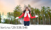 Купить «happy woman in fur hat over winter forest», фото № 29538546, снято 7 января 2017 г. (c) Syda Productions / Фотобанк Лори