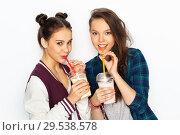 happy teenage girls drinking milk shakes. Стоковое фото, фотограф Syda Productions / Фотобанк Лори