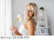 Купить «woman in underwear with peony flower at window», фото № 29538610, снято 20 апреля 2017 г. (c) Syda Productions / Фотобанк Лори