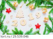 Купить «New Year 2019 background with 2019 figures,Christmas toys, fir branches. Flat lay, top view-New Year 2019 still life», фото № 29539046, снято 30 ноября 2016 г. (c) Зезелина Марина / Фотобанк Лори