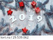 Купить «New Year 2019 background, 2019 figures, Christmas toys, blue fir tree branches and snowflakes. New Year 2019 still life», фото № 29539062, снято 29 ноября 2016 г. (c) Зезелина Марина / Фотобанк Лори