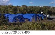 Купить «Army field tents town of Emercom of Russian Federation», видеоролик № 29539490, снято 2 октября 2018 г. (c) А. А. Пирагис / Фотобанк Лори