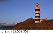 Купить «Petropavlovsk Lighthouse on Pacific Coast of Kamchatka Peninsula», видеоролик № 29539958, снято 15 октября 2018 г. (c) А. А. Пирагис / Фотобанк Лори