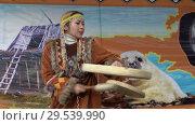 Купить «Incendiary dance of indigenous inhabitants of Kamchatka with tambourine», видеоролик № 29539990, снято 4 ноября 2018 г. (c) А. А. Пирагис / Фотобанк Лори