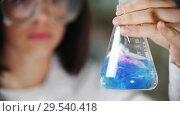 Купить «A woman mixing a flask with a chemical substance», видеоролик № 29540418, снято 25 февраля 2020 г. (c) Константин Шишкин / Фотобанк Лори