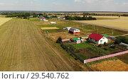 Купить «Rural autumn landscape from height in Russia», видеоролик № 29540762, снято 18 ноября 2019 г. (c) Володина Ольга / Фотобанк Лори