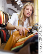 Купить «Woman choosing leather jacket», фото № 29542754, снято 5 сентября 2018 г. (c) Яков Филимонов / Фотобанк Лори