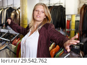 Купить «Woman trying on leather jacket», фото № 29542762, снято 5 сентября 2018 г. (c) Яков Филимонов / Фотобанк Лори