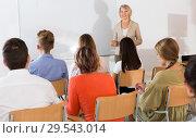 Купить «Students listening to lecture of female teacher», фото № 29543014, снято 20 мая 2019 г. (c) Яков Филимонов / Фотобанк Лори