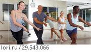 Купить «Group of multinational smiling people practicing new dance techniques», фото № 29543066, снято 30 июля 2018 г. (c) Яков Филимонов / Фотобанк Лори