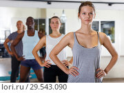 Group of active young people practicing hatha yoga workout. Стоковое фото, фотограф Яков Филимонов / Фотобанк Лори