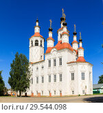 Купить «Russian white orthodox Temple of the Entry of the Lord into Jerusalem against the blue sky The Nativity Church, Totma, Russia. Architectural forms reminiscent of a ship», фото № 29544098, снято 17 июня 2019 г. (c) Mikhail Starodubov / Фотобанк Лори