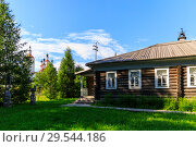 Купить «Wooden house withcarved platbands in Totma. Russian traditional architecture lies in wooden houses with manually carved decorations, often painted in white», фото № 29544186, снято 17 июня 2019 г. (c) Mikhail Starodubov / Фотобанк Лори