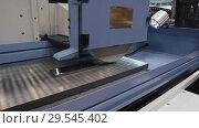 Купить «Work of an industrial surface grinding machine. Grinding of a flat metal part.», видеоролик № 29545402, снято 25 октября 2018 г. (c) Андрей Радченко / Фотобанк Лори