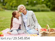 grandmother and granddaughter at picnic in park. Стоковое фото, фотограф Syda Productions / Фотобанк Лори
