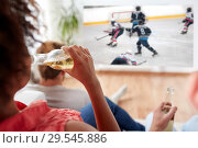 Купить «friends watching ice hockey and drinking beer», фото № 29545886, снято 14 августа 2016 г. (c) Syda Productions / Фотобанк Лори