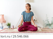 Купить «woman meditating in lotus pose at yoga studio», фото № 29546066, снято 21 июня 2018 г. (c) Syda Productions / Фотобанк Лори
