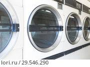 Купить «washing machines at laundromat», фото № 29546290, снято 28 февраля 2018 г. (c) Syda Productions / Фотобанк Лори