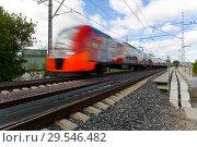 Купить «The train quickly travels along the Moscow Central Ring», фото № 29546482, снято 27 мая 2017 г. (c) Александр Клёнов / Фотобанк Лори
