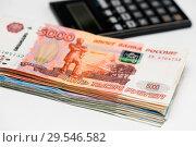 Купить «Российские рубли и калькулятор на белом фоне», эксклюзивное фото № 29546582, снято 3 декабря 2018 г. (c) Игорь Низов / Фотобанк Лори