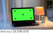 Купить «laptop with chroma key green screen on table», видеоролик № 29546618, снято 25 мая 2020 г. (c) Syda Productions / Фотобанк Лори