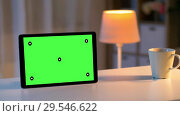 Купить «tablet computer with green screen on table at home», видеоролик № 29546622, снято 10 декабря 2018 г. (c) Syda Productions / Фотобанк Лори