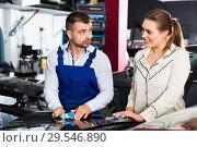 Купить «Serious car painter discussing with female client, picking up color of paint in auto repair shop», фото № 29546890, снято 4 апреля 2018 г. (c) Яков Филимонов / Фотобанк Лори