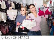 Купить «Women shopping uplifts and panties», фото № 29547102, снято 16 января 2019 г. (c) Яков Филимонов / Фотобанк Лори