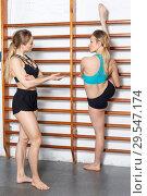 Купить «Women exercising in gym», фото № 29547174, снято 10 мая 2018 г. (c) Яков Филимонов / Фотобанк Лори