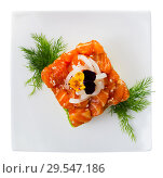 Top view of cube-shaped salmon tartare with avocado. Стоковое фото, фотограф Яков Филимонов / Фотобанк Лори