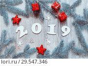 Купить «New Year 2019 background, 2019 figures, Christmas toys, blue fir tree branches and snowflakes. New Year 2019 design», фото № 29547346, снято 29 ноября 2016 г. (c) Зезелина Марина / Фотобанк Лори